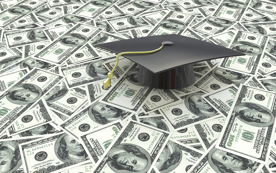 Mini graduation cap on US money -- education costs in the design of information related to the cost of education